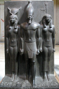 Menkaure with Hathor on the left and Bat on the righ