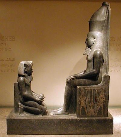 Horemheb in front of Atum, Luxor Museum, copyrigh Gerard Ducher