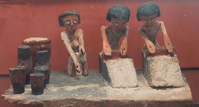 Ancient Egyptian brewers grinding grain, from the Middle Kingdom copyright Sully