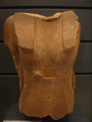 Statue of Sobekneferu wearing a sheath dress and a kilt, Louvre