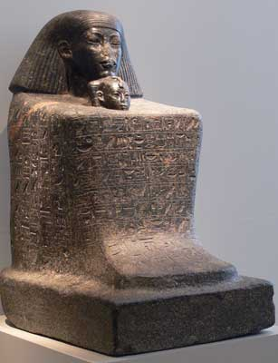 Statue of Senenmut with princess Neferure emerging from his body