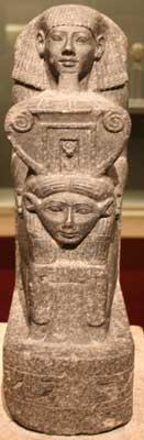 Statue of Senenmut holding a Hathor headed sistrum (copyright Einsamer Schutze)