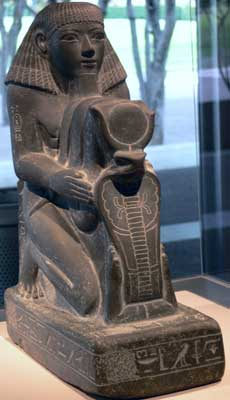 Statue of Senenmut presenting glyphs that form the throne name of Hatshepsut (Maatkare)