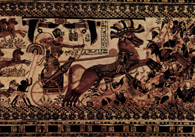 Tutankhamun on his chariot wearing the blue war crown