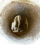 View of the statue of Djoser through the hole in the serdab (copyright Roweromaniak)