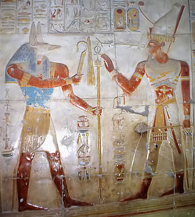 Wepwawet offering regal insignia to Seti I, Abydos (copyright Roland Unger)